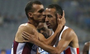 Mohamad Al Garni kisses 2nd placer Rashid Ramzi after their 1,500m battle.  Al garni became the 1st double gold medalist of the athletics competitions in the 17th Asiad. Photcredit; Reuters