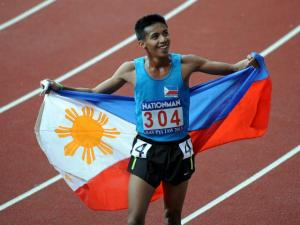 Christopher Ulboc Jr. celebrates after his win in the 2013 SEA Games steeplechase finals