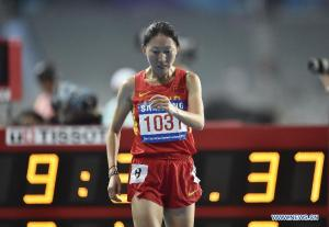 ZhenZhu Li of China was awarded the 3,000m steeplechase gold after Bahraini Ruth Jebet was disqualified for running inside the lane
