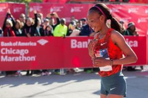 Rita Jeptoo of Kenya wins defended her Chicago Marathon title.  She is not the back to back title holder of the Boston and Chicago Marathons (Photocredits: Andrew Seligman / AP)