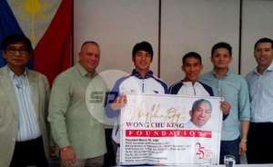 Jesson Cid formally adopted by Wong Chu King Foundation last August.  Also in the inset are: PATAFA President Philip Juico, Mr Lafferty, Coach Sean Guevarra