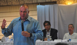Lafferty discusses his program to the media as Juico and GTK looks on at the back during the turnover of PATAFA Presidency (Photocredit: Manila Standard Today)